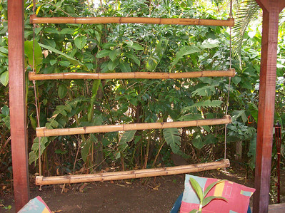 I had this created by one of the workers where I used to live - BB.  This design can have multi-purposes!  I used it as a bird/squirrel feeder (hours of entertainment!).  OR, You can grow herbs, lettuce, flowers & all sorts of stuff (all depending on how big the bamboo is).  You can also get vine-y things like beans which will also create a privacy barrier!!  Another trick I learned is instead of putting rocks at the bottom of the dirt (to help with drainage), break up a bunch of styrofoam things (to-go boxes, coffee cups+)!! (best not to do it with food related things if you're concerned with being organic, etc.)  You can hang this from a roof or ceiling or hang it from a wall.  If you drill holes in the bottom for drainage, you'll need to put it outside.  If not, you can put this inside.