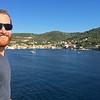 Sam of forgetsomeday.com enjoying the sunshine pulling into port in Vis Croatia