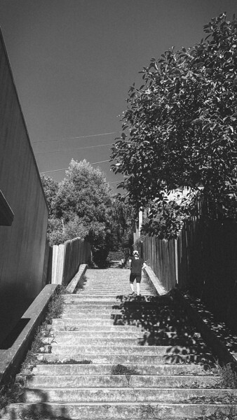 LUKE WICKER climbing the stairs between San Marcos Ave and 9th.