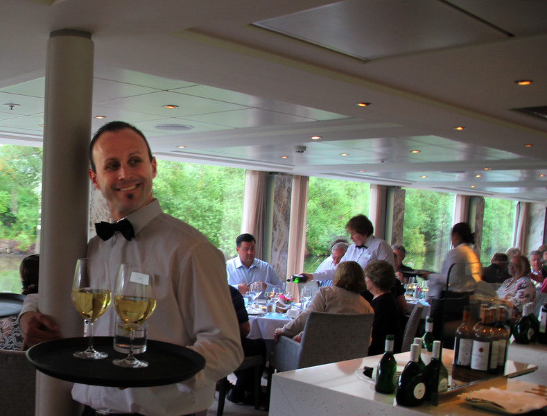 Viking River Cruise, Smiling Server, long view on diners