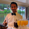 Viking River Cruise, Charming Server Offering a Welcome Drink