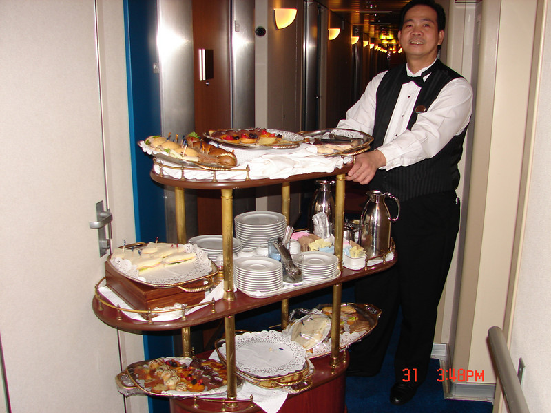 Our butler, with the daily (to the door) selection of afternoon goodies!
