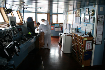 On board M/S ATHENA : the bridge, navigators on duty.
