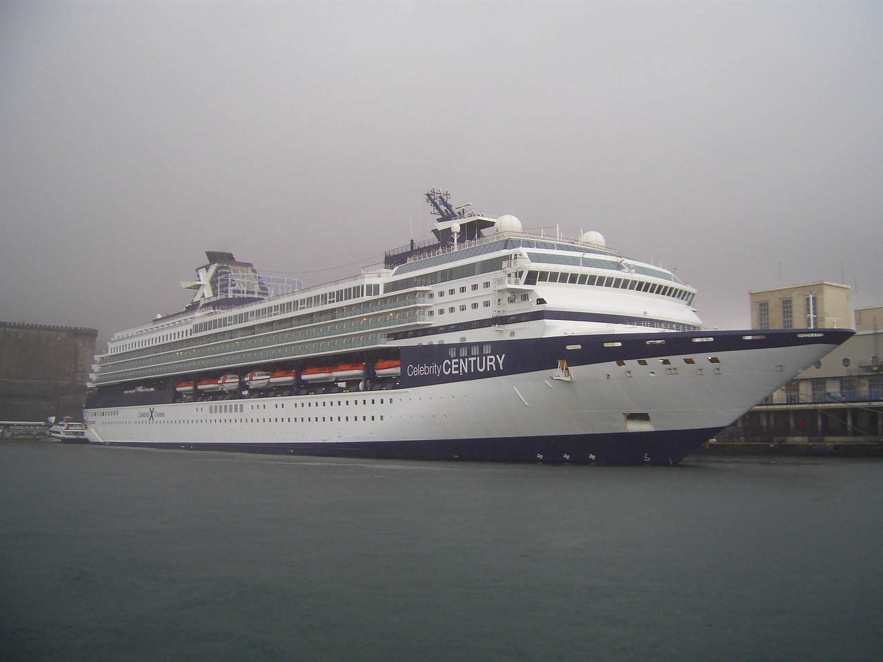 M/S CELEBRITY CENTURY moored in Napoli in a rainy day.