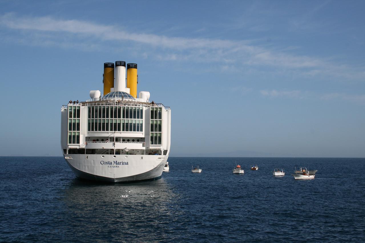 M/S COSTA MARINA offshore Capri. Local boats waiting for the disembarking.