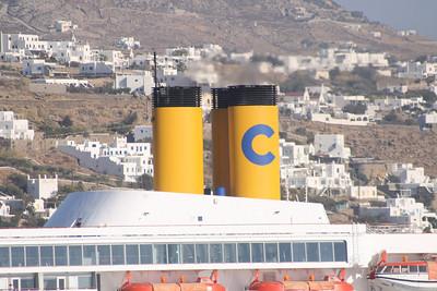 M/S COSTA ROMANTICA offshore Mykonos. The funnels.