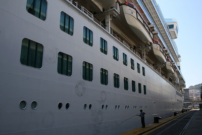 M/S CROWN PRINCESS moored in Napoli. Washing broadside.