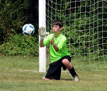 Sean Kolimaga concentrates on save.