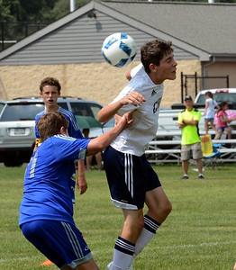 Braden Mallon, right, goes for headball.