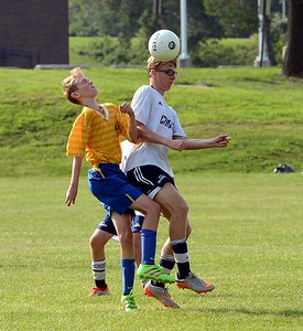 Kyle Gartenmayer, right, wins header against Hulmeville.