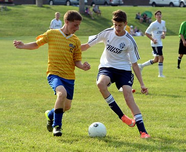 Chris Milligan, right, battles Hulmeville attacker for possession.