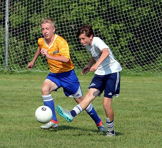 Jacob Stoltz clears ball by Hulmeville opponent.