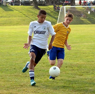 Jayden Browne, left, brings ball up on the wing.