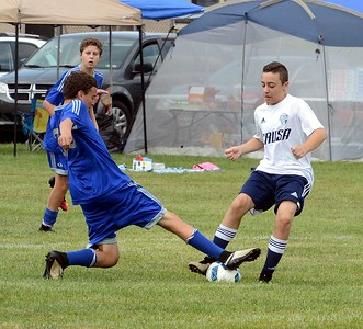 Antonio Santos, right, of CRUSA, battles for control of the ball.