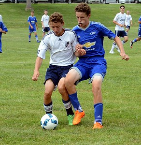 Hanlon Doyle battles PA Rush opponent for possession.
