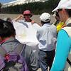 Below Mount Hood, Cynthia Gardiner (USGS CVO) shows the CSAV International group a map of geologic hazards posed by the volcano.