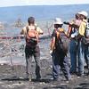Matt Patrick (USGS HVO, yellow shirt) coaches the CSAV International group in how to map an active lava flow in Kalapana.