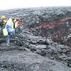 CSAV International students wear rain gear on a hike as they observe collapse features on Mauna Iki in Kau.