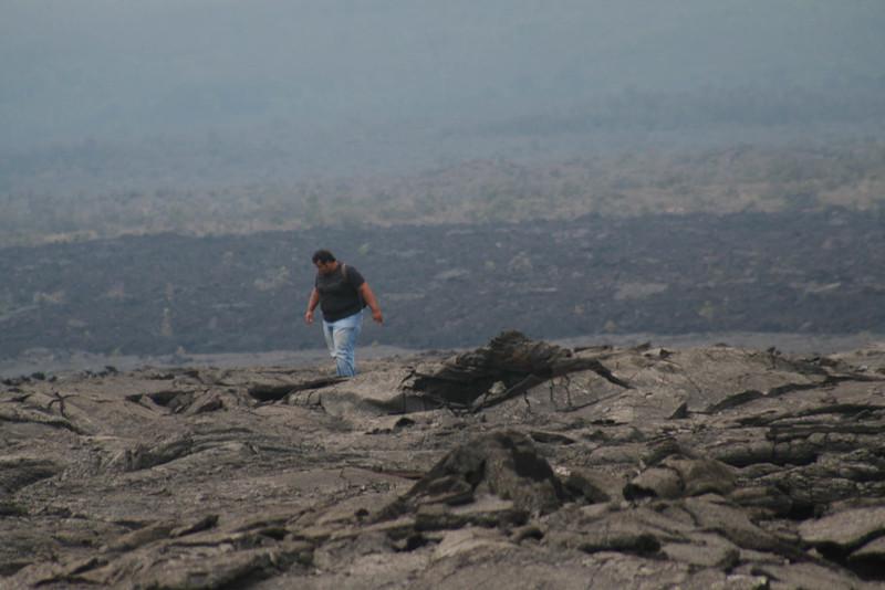 Mohammed Hakami (Saudi Arabia) hikes across rugged terrain in Kau as part of the CSAV International course.