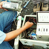 Technician George Kojima demonstates how to set up a telemetry field station for the CSAV International participants.