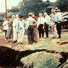 In 1960, prior to the volcanic eruption at Kapoho, Hawaii, an earthquake produced a large crack on a grassy area in the village; residents and officials examine the crack.