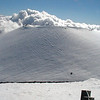 A cinder cone on the summit of Mauna Kea is covered in snow in winter. Photo by David Whilldin.