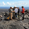 UH Hilo Geology Professor Ken Hon talks to his students about the measurements they will be taking (primarily lava temperatures), emphasizing safety. Photo by Drew Lubiniecki.