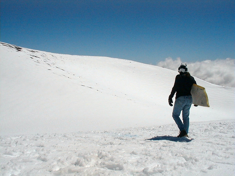 On Mauna Kea, the winter snow provides ideal conditions for sledding. Photo by David Whilldin.