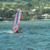 Windsurfer Darcy Bevens races across Hilo Bay. Photo by Peter Charlot.