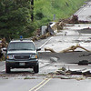 A police officer surveys damage to the road near Pahala following the Big Island flood of 2000.
