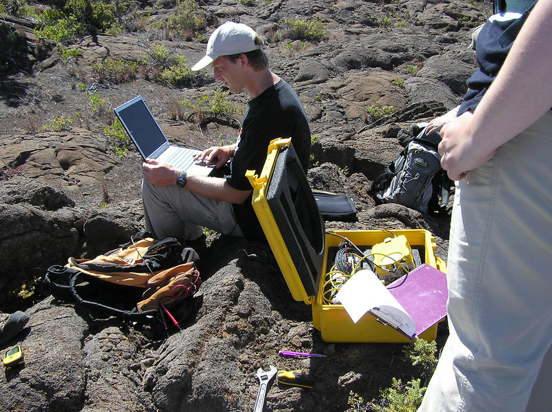 Scientist James Foster sets up a laptop to collect GPS data. Photo by Pam Stewart.