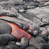 A pahoehoe flow breaks out, rafting a slab of crust. Photo by Trystan Glynn-Morris.