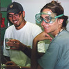 Students in lab analyze gas samples; note safety goggles. Photo by CSAV.