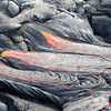 Three separate lobes of lava break out from a pahoehoe flow on Kilauea. Photo by Jack Dykinga.