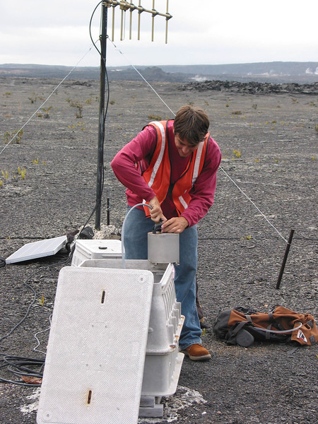 Jason Meyer, UH Hilo geology student, assists with repairing a broadband seismic telemetry station. Photo by David Whilldin.
