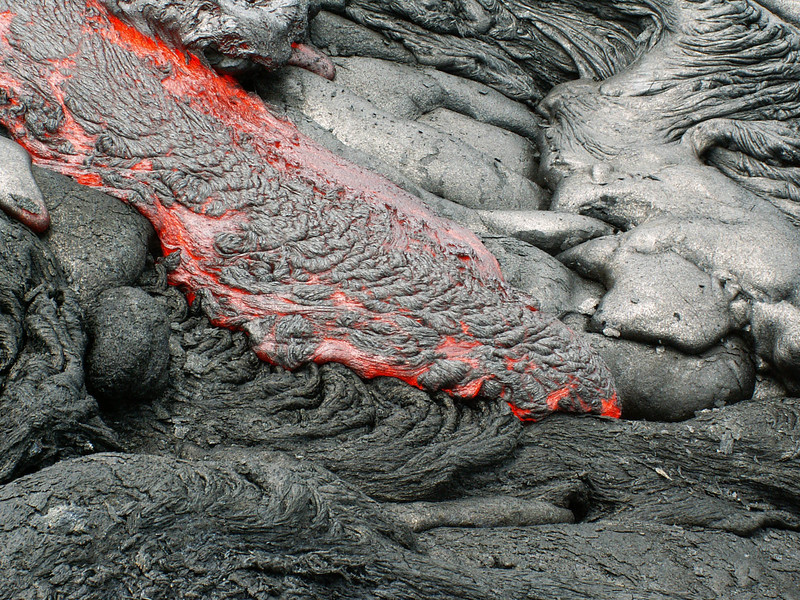A pahoehoe flow forms ropy texture as it cascades downhill. Photo by Jose Luis Palma.