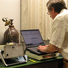 In the lab, scientist Don Thomas uses a Gas Chromatagraph (GC) to analyze volcanic gas. Photo by Pam Stewart.