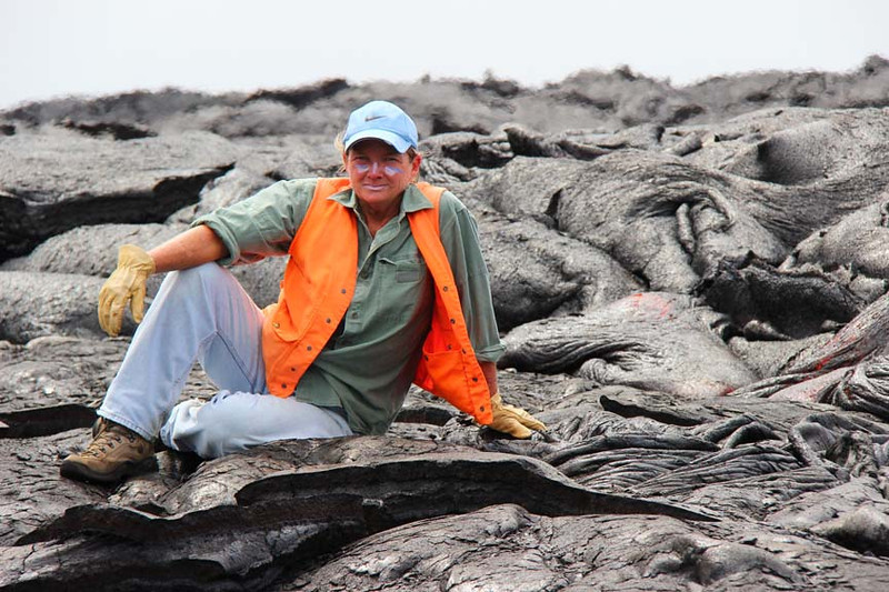CSAV geologist Darcy Bevens takes a break after hiking out to active lava flows near Kalapana; note protective clothing.