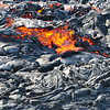 A pahoehoe lava flow cascades down the pali near Royal Gardens, exposing the molten interior near the terminus. Photo by Drew Lubiniecki.