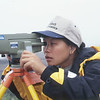 UH Hilo geology student Francine Coloma uses a NAK-2 gun to measure deformation in a leveling survey. Photo by CSAV.