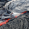 Molten lava breaks out from the terminus of a pahoehoe flow on Kilauea. Photo by Jack Dykinga.