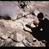 A scientist measures gas emissions from a fumarole on Mount St. Helens.