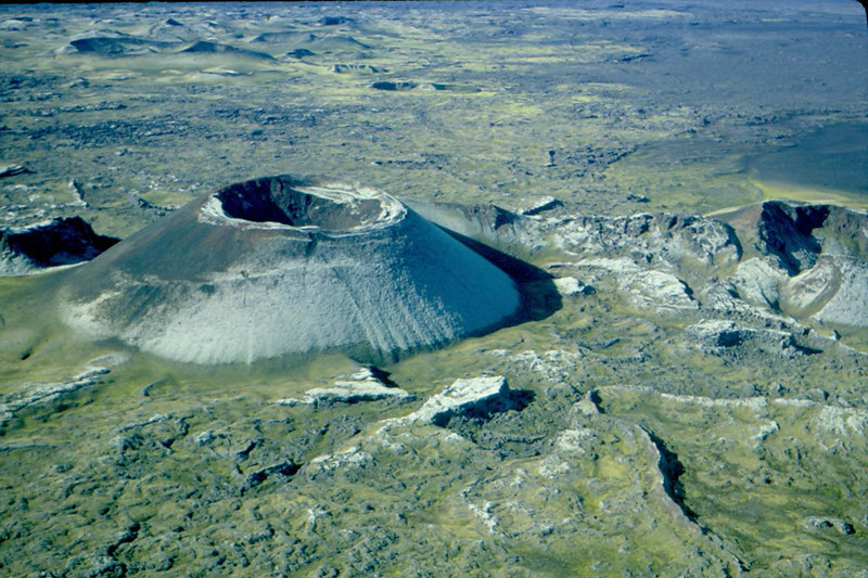 Laki eruption in Iceland. View from the air of a cinder cone formed by high lava fountains during the 1783 eruption. This huge outpouring of lava from a 25-kilometer-long fissure totaled 12 cubic kilometers of basalt and covered 565 square kilometers of land -- the largest flow in recorded history. Photo by Robert Decker.