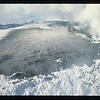 Ash blankets the snow-capped summit of Nevado del Ruiz.