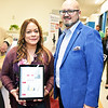 Rosa Torres and Ricardo Torres with their Commercial Program Intereactive Impact Report Data Visualization program.