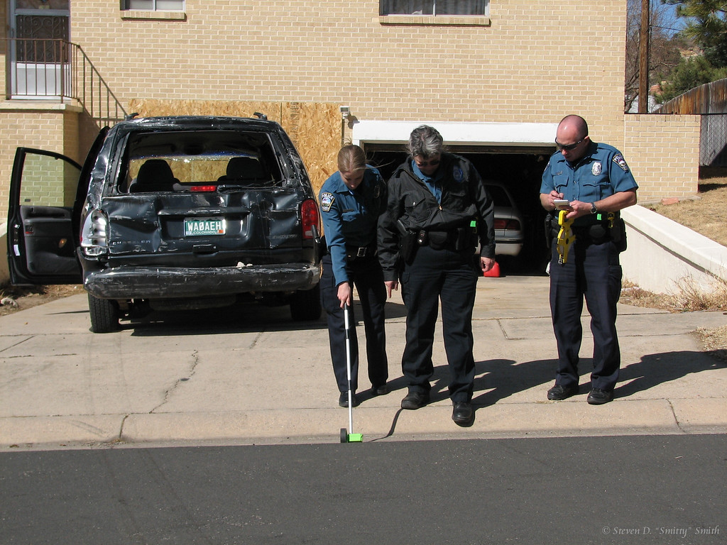 CSPD Officers Huffman, Turechek  and Aulino take measurements of the incident.