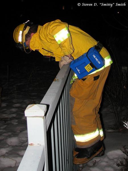 Captain Pat Rogacki scaling a fence.