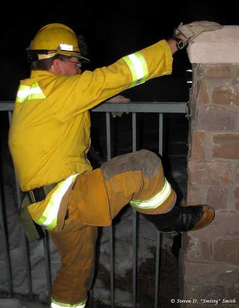 Captain Pat Rogacki scaling a fence. Still.