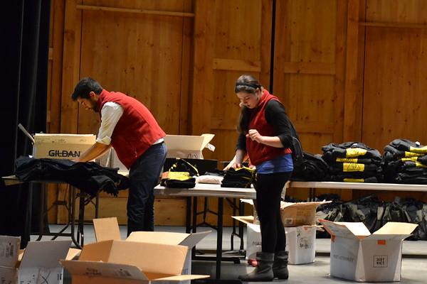 June 13, 2015 (13) Staff folding tee shirts