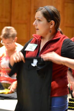 June 13, 2015 (14) Staff Folding tee shirts
